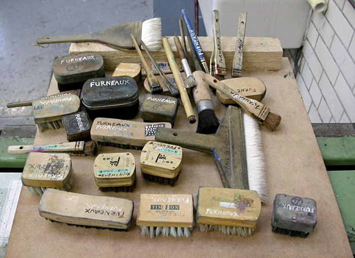 Table with around 40 brushes, various sizes and types, marked with 'Paul Furneaux'